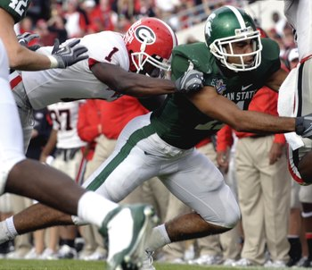 ORLANDO, FL - JANUARY 1: Running back Knowshon Moreno #24 of the University of Georgia rushes upfield against the tackle of safety Marcus Hyde #11 of the Michigan State Spartans at the 2009 Capital One Bowl at the Citrus Bowl on January 1, 2009 in Orlando
