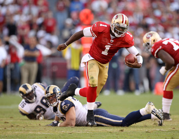 SAN FRANCISCO - NOVEMBER 14:  Troy Smith #49 of the San Francisco 49ers runs with the ball during their game against the St. Louis Rams at Candlestick Park on November 14, 2010 in San Francisco, California.  (Photo by Ezra Shaw/Getty Images)