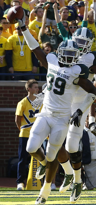 ANN ARBOR, MI - OCTOBER 09: Trenton Robinson #39 of the Michigan State Spartans celebrates a first quarter interception off a pass from Denard Robinson #16 of the Michigan Wolverines during the game on October 9, 2010 at Michigan Stadium in Ann Arbor, Mic