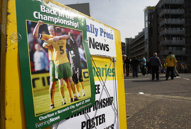NORWICH, ENGLAND - APRIL 24: A newspaper stand outside Norwich City celebrates the team's return to the Championship before the Coca Cola League One match between Norwich City and Gillingham at Carrow Road on April 24, 2010 in Norwich, England. (Photo by
