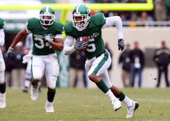 EAST LANSING, MI - NOVEMBER 08:  Johnny Adams #5of the Michigan State Spartans runs an interception against the Purdue Boilermakers for a touchdown at Spartan Stadium on November 8, 2008 in East Lansing, Michigan.  (Photo by Jim McIsaac/Getty Images)