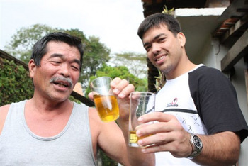 Cheers - Yoshizo and son Lyoto share a glass of urine!