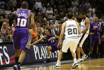 SAN ANTONIO - MAY 14:  Guard Steve Nash #13 of the Phoenix Suns falls out of bounds after a flagrant foul by Robert Horry #5 of the San Antonio Spurs in Game Four of the Western Conference Semifinals during the 2007 NBA Playoffs on May 14, 2007 at AT&T Ce