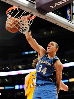 LOS ANGELES, CA - JANUARY 22:  JaVale McGee #34 of the Washington Wizards slams the ball against Pau Gasol of the Los Angeles Lakers during the second quarter at the Staples Center January 22, 2009 in Los Angeles, California. NOTE TO USER: User expressly
