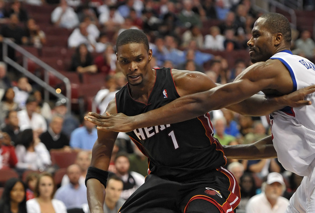 PHILADELPHIA - OCTOBER 27: Chris Bosh #1 of the Miami Heat tries to drive around Elton Brand #42 of the Philadelphia 76ers at the Wells Fargo Center on October 27, 2010 in Philadelphia, Pennsylvania. NOTE TO USER: User expressly acknowledges and agrees th