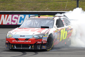 LONG POND, PA - AUGUST 01:  Greg Biffle, driver of the #16 3M Ford, performs a burnout after winning the NASCAR Sprint Cup Series Sunoco Red Cross Pennsylvania 500 at Pocono Raceway on August 1, 2010 in Long Pond, Pennsylvania.  (Photo by Drew Hallowell/G