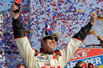 KANSAS CITY, KS - OCTOBER 03:  Greg Biffle, driver of the #16 3M Ford, celebrates in victory lane after winning the NASCAR Sprint Cup Series Price Chopper 400 on October 3, 2010 in Kansas City, Kansas.  (Photo by John Harrelson/Getty Images for NASCAR)
