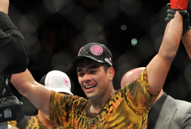 LOS ANGELES, CA - OCTOBER 24:  UFC Light Heavyweight Champion Lyoto Machida celebrates his victory over UFC Light Heavyweight challenger Mauricio Rua (not pictured) in their title fight at UFC 104 at Staples Center on October 24, 2009 in Los Angeles, Cali