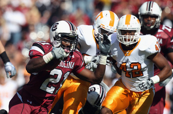 COLUMBIA, SC - OCTOBER 30:  LaMarcus Thompson #42 of the Tennessee Volunteers tries to stop Marcus Lattimore #21 of the South Carolina Gamecocks during their game at Williams-Brice Stadium on October 30, 2010 in Columbia, South Carolina.  (Photo by Street