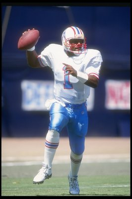 19 Sep 1993:  Quarterback Warren Moon of the Houston Oilers looks to pass the ball during a game against the San Diego Chargers at Jack Murphy Stadium in San Diego, California.  The Chargers won the game, 18-17. Mandatory Credit: Stephen Dunn  /Allsport