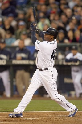 SEATTLE - APRIL 15:  Ken Griffey Jr #24 of the Seattle Mariners swings at the pitch during the game against the Los Angeles Angels of Anaheim on April 15, 2009 at Safeco Field in Seattle, Washington. All Major League Baseball players are wearing #42 in ho