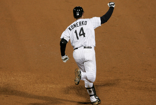 CHICAGO - OCTOBER 23:  Paul Konerko #14 of the Chicago White Sox celebrates after hitting a grandslam home run against the Houston Astros in the seventh inning during Game Two of the 2005 Major League Baseball World Series at U.S. Celluar Field on October