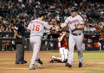 PHOENIX - AUGUST 04:  Adam Dunn #44 of the Washington Nationals is congratulated by teammate Josh Willingham #16 after hitting a solo home run against the Arizona Diamondbacks during the fourth inning of the Major League Baseball game at Chase Field on Au