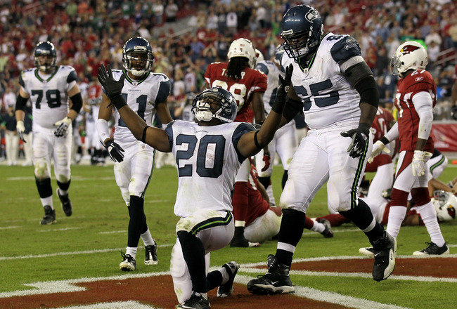 GLENDALE, AZ - NOVEMBER 14:  Running back Justin Forsett #20 of the Seattle Seahawks celebrates his four yard touchdown carry with center Chris Spencer #65 against the Arizona Cardinals in the fourth quarter at University of Phoenix Stadium on November 14