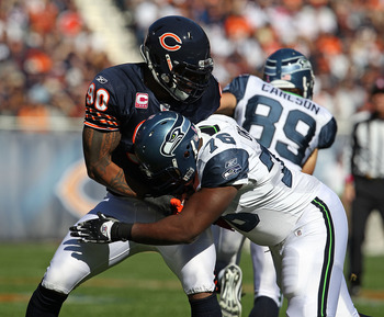 CHICAGO - OCTOBER 17: Julius Peppers #90 of the Chicago Bears rushes against Russell Okung #76 of the Seattle Seahawks at Soldier Field on October 17, 2010 in Chicago, Illinois. The Seahawks defeated the Bears 23-20. (Photo by Jonathan Daniel/Getty Images