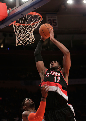 NEW YORK - OCTOBER 30:  LaMarcus Aldridge #12 of the Portland Trail Blazers dunks over Amar'e Stoudemire #1 of the New York Knicks at Madison Square Garden on October 30, 2010 in New York City. NOTE TO USER: User expressly acknowledges and agrees that, by