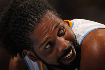 DENVER - NOVEMBER 16:  Nene #31 of the Denver Nuggets looks on during a break in the action against the New York Knicks at the Pepsi Center on November 16, 2010 in Denver, Colorado. The Nuggets defeated the Knicks 120-118. NOTE TO USER: User expressly ack