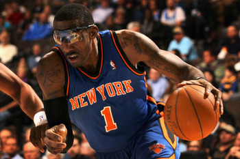 DENVER - NOVEMBER 16:  Amar'e Stoudemire #1 of the New York Knicks drive the ball against the Denver Nuggets at the Pepsi Center on November 16, 2010 in Denver, Colorado. The Nuggets defeated the Knicks 120-118. NOTE TO USER: User expressly acknowledges a