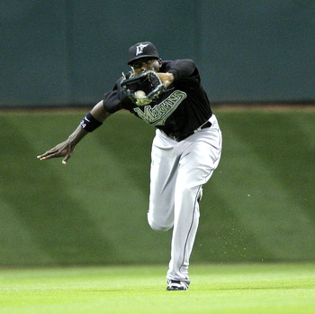 HOUSTON - APRIL 20:  Center fielder Cameron Maybin #24 of the Florida Marlins makes a running catch on a ball hit by Pedro Feliz of the Houston Astros in the fourth inning at Minute Maid Park on April 20, 2010 in Houston, Texas.  (Photo by Bob Levey/Getty