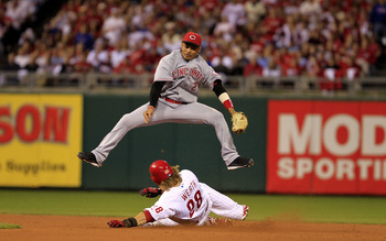 PHILADELPHIA - OCTOBER 08:  Orlando Cabrera #2 of the Cincinnati Reds leaps over Jayson Werth #28 of the Philadelphia Phillies as Werth steals second base during game 2 of the NLDS at Citizens Bank Park on October 8, 2010 in Philadelphia, Pennsylvania. Th