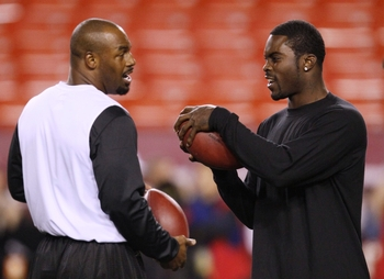 LANDOVER, MD - OCTOBER 26:  Donovan McNabb #5 of the Philadelphia Eagles (L) talks with teammate Michael Vick #7 (R) as they warm up prior to the game against the Washington Redskins at FedEx Field October 26, 2009 in Landover, Maryland. (Photo by Win McN