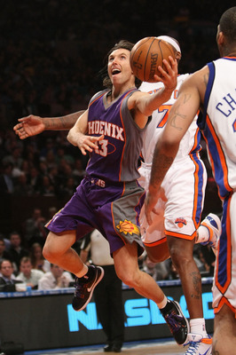 NEW YORK - DECEMBER 01:  Steve Nash #13 of the Phoenix Suns lays the ball up against the New York Knicks at Madison Square Garden on December 1, 2009 in New York, New York. NOTE TO USER: User expressly acknowledges and agrees that, by downloading and/or u