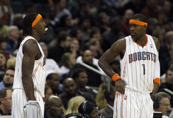 CHARLOTTE, NC - NOVEMBER 08:  Teammates Gerald Wallace #3 and Stephen Jackson #1 of the Charlotte Bobcats wait to check into the game against the San Antonio Spurs at Time Warner Cable Arena on November 8, 2010 in Charlotte, North Carolina.  NOTE TO USER: