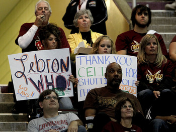 CLEVELAND - OCTOBER 27:  Fans of the Cleveland Cavaliers hold up signs expressing their thoughts about LeBron James while playing the Boston Celtics at Quicken Loans Arena on October 27, 2010 in Cleveland, Ohio.  (Photo by Gregory Shamus/Getty Images)