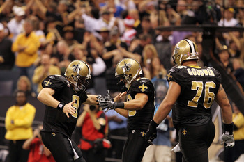 NEW ORLEANS, LA - OCTOBER 31: Drew Brees #9 and Lance Moore #16 of the New Orleans Saints celebrate a touchdown during the game against the Pittsburgh Steelers at the Louisiana Superdome on October 31, 2010 in New Orleans, Louisiana. (Photo by Matthew Sha