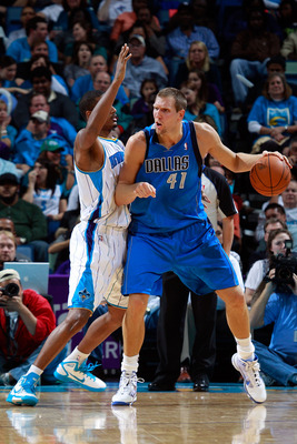 NEW ORLEANS - NOVEMBER 17:  Dirk Nowitzki #41 of the Dallas Mavericks drives the ball around Trevor Ariza #1 of the New Orleans Hornets at the New Orleans Arena on November 17, 2010 in New Orleans, Louisiana.  The Hornets defeated the Mavericks 99-97.  NO