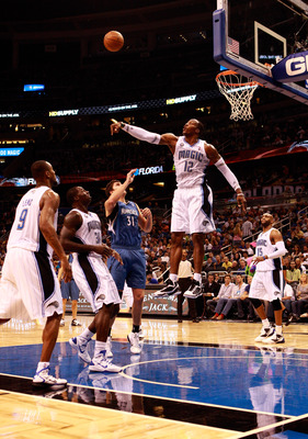 ORLANDO, FL - NOVEMBER 03:  Dwight Howard #12 of the Orlando Magic blocks the shot of Darko Milicic #31 of the Minnesota Timberwolves during the game at Amway Arena on November 3, 2010 in Orlando, Florida.  NOTE TO USER: User expressly acknowledges and ag