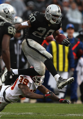 OAKLAND, CA - NOVEMBER 07:  Darren McFadden #20 of the Oakland Raiders runs against Brandon Carr #39 of the Kansas City Chiefs during an NFL game at Oakland-Alameda County Coliseum on November 7, 2010 in Oakland, California.  (Photo by Jed Jacobsohn/Getty