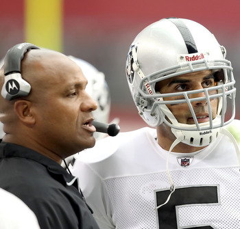 GLENDALE, AZ - SEPTEMBER 26:  Quarterback Bruce Gradkowski #5 of the Oakland Raiders talks with offensive coordinator Hue Jackson during the NFL game against the Arizona Cardinals at the University of Phoenix Stadium on September 26, 2010 in Glendale, Ari