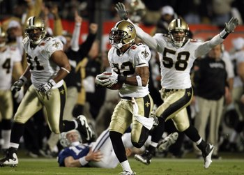 MIAMI GARDENS, FL - FEBRUARY 07: Tracy Porter #22 of the New Orleans Saints intercepts a ball and thrown by Peyton Manning #18 of the Indianapolis Colts and returns it for a touchdown in the fourth quarter during Super Bowl XLIV on February 7, 2010 at Sun