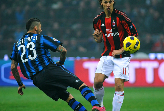 MILAN, ITALY - NOVEMBER 14:  Marco Materazzi of FC Internazionale Milano clashes with Zlatan Ibrahimovic of AC Milan during the Serie A match between FC Internazionale Milano and AC Milan at Stadio Giuseppe Meazza on November 14, 2010 in Milan, Italy.  (P