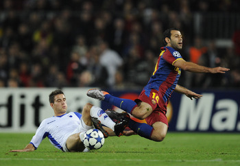 BARCELONA, SPAIN - OCTOBER 20:  Martin Vingaard of FC Copenhagen (L) and Javier Mascherano of Barcelona duels for a ball during the UEFA Champions League group D match between Barcelona and FC Copenhagen at the Camp nou stadium on October 20, 2010 in Barc