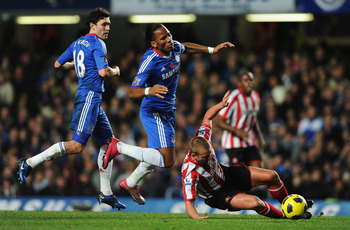 LONDON, ENGLAND - NOVEMBER 14:  Didier Drogba of Chelsea is tackled by Lee Cattermole of Sunderland during the Barclays Premier League match between Chelsea and Sunderland at Stamford Bridge on November 14, 2010 in London, England.  (Photo by Michael Rega