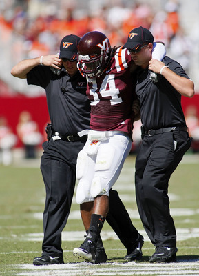 BLACKSBURG, VA - SEPTEMBER 18:  Running back Ryan Williams #34 of the Virginia Tech Hokies is helped off the field after being injured in the first half against the East Carolina Pirates at Lane Stadium on September 18, 2010 in Blacksburg, Virginia.  (Pho
