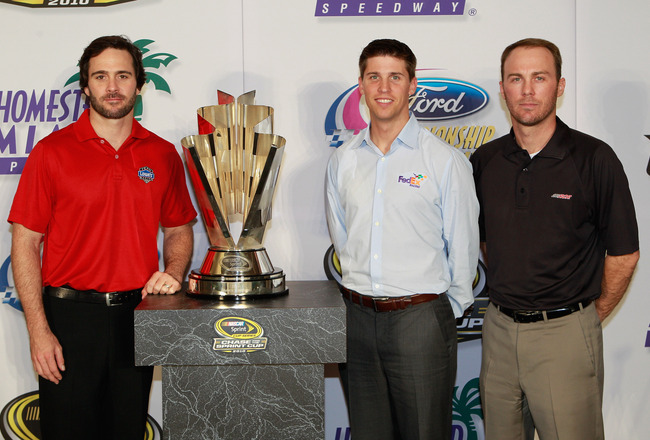 CORAL GABLES, FL - NOVEMBER 18:  Jimmie Johnson, (L) driver of the #48 Lowe's Chevorlet, Denny Hamlin, driver of the #11 FedEx Toyota, and Kevin Harvick (R), driver of the #29 Shell/Penzoil Chevorlet, pose with the NASCAR Championship trophy following the