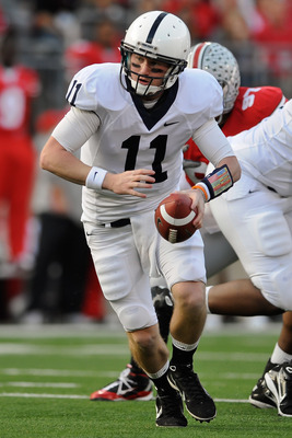 COLUMBUS, OH - NOVEMBER 13:  Quarterback Matt McGloin #11 of the Penn State Nittany Lions hands off against the Ohio State Buckeyes at Ohio Stadium on November 13, 2010 in Columbus, Ohio.  (Photo by Jamie Sabau/Getty Images)