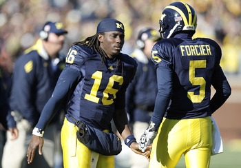ANN ARBOR, MI - NOVEMBER 06:  Denard Robinson #16 of the Michigan Wolverines congratulates Tate Forcier #5 after scoring in the second overtime while playing the Illinios Fighting Illini at Michigan Stadium on November 6, 2010 in Ann Arbor, Michigan. Robi