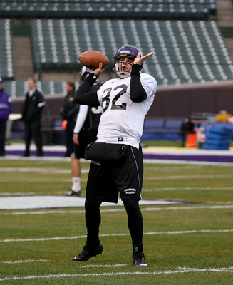 CHICAGO - NOVEMBER 18: Evan Watkins #82 of Northwestern Wildcats, who will start at quarterback, throws a pass during practice for a game against the Illinois Fighting Illini on Saturday November 20 at Wrigley Field on November 18, 2010 in Chicago, Illino