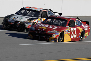 TALLADEGA, AL - OCTOBER 31:  Clint Bowyer, driver of the #33 BB&T Chevrolet, leads Kevin Harvick, driver of the #29 RealTree/Shell/Pennzoil Chevrolet, with 2 laps remaining during the NASCAR Sprint Cup Series AMP Energy Juice 500 at Talladega Superspeedwa