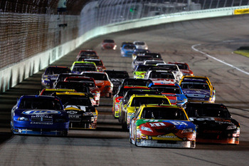 HOMESTEAD, FL - NOVEMBER 22:  Kyle Busch, driver of the #18 M&M's Toyota, and Kurt Busch, driver of the #2 Miller Lite Dodge, lead the pack during the NASCAR Sprint Cup Series Ford 400 at Homestead-Miami Speedway on November 22, 2009 in Homestead, Florida