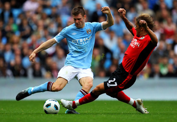 MANCHESTER, ENGLAND - SEPTEMBER 11:  James Milner of Manchester City is challenged by Michel Salgado of Blackburn Rovers during the Barclays Premier League match between Manchester City and Blackburn Rovers at the City of Manchester Stadium on September 1