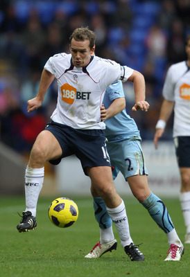 BOLTON, ENGLAND - NOVEMBER 06:  Kevin Davies of Bolton Wanderers holds off a challenge from Alan Hutton of Tottenham Hotspur during the Barclays Premier League match between Bolton Wanderers and Tottenham Hotspur at the Reebok Stadium on November 6, 2010