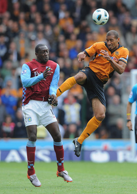 WOLVERHAMPTON, ENGLAND - SEPTEMBER 26: Karl Henry of Wolves in action with Emile Heskey of Aston Villa during the Barclays Premier League match between Wolverhampton Wanderers and Aston Villa at Molineux on September 26, 2010 in Wolverhampton, England.  (