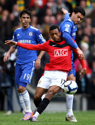MANCHESTER, ENGLAND - APRIL 03:  Michael Ballack of Chelsea challenges Nani of Manchester United during the Barclays Premier League match between Manchester United and Chelsea at Old Trafford on April 3, 2010 in Manchester, England. (Photo by Alex Livesey
