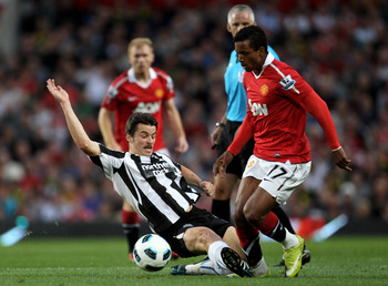 MANCHESTER, ENGLAND - AUGUST 16:  Joey Barton of Newcastle United tackles Nani of Manchester United during the Barclays Premier League match between Manchester United and Newcastle United at Old Trafford on August 16, 2010 in Manchester, England.  (Photo