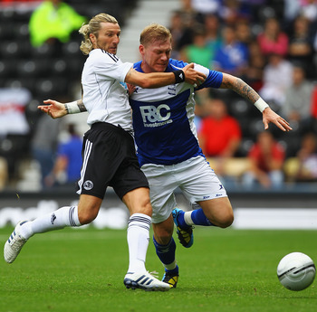 DERBY, ENGLAND - JULY 31:  Robbie Savage of Derby and Garry O'Connor of Birmingham challenge for the ball during the Pre-Season Friendly match between Derby County and Birmingham City at the County Ground on July 31, 2010 in Derby, England.  (Photo by Mat